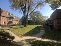 1574183170 spring manor   sunny view of space between buildings